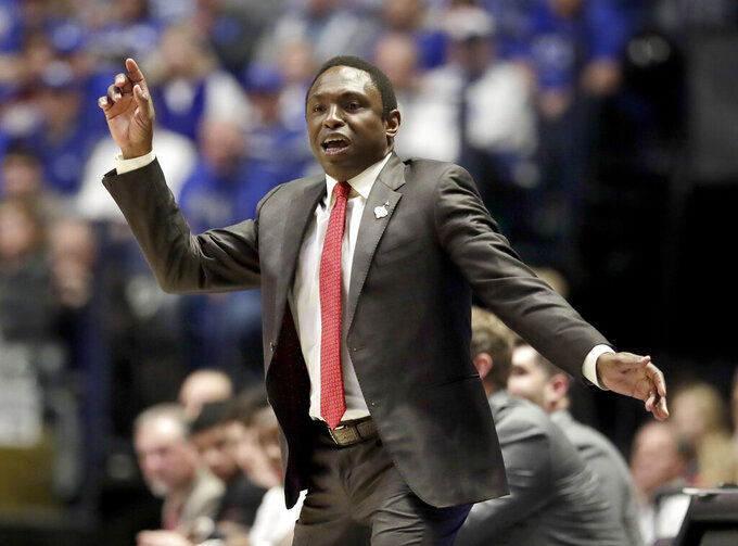 Alabama head coach Avery Johnson watches the action in the first half of an NCAA college basketball game against Kentucky at the Southeastern Conference tournament Friday, March 15, 2019, in Nashville, Tenn. (AP Photo/Mark Humphrey)