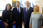 Guatemala President Jimmy Morales, center left, and his wife Hilda Patricia Marroquin, left, pose for the media with Israel Prime Minister Benjamin Netanyahu and his wife Sara ahead of the dedication ceremony of the Guatemala Embassy in Jerusalem, Israel, Wednesday May 16, 2018. (Ronen Zvulun/Pool via AP)