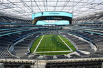 FILE - In this Sept. 4, 2020, file photo, The playing field and seating areas of SoFi Stadium, future home for NFL football's Los Angeles Rams and Los Angeles Chargers, is viewed in Inglewood, Calif. Welcome to Sofi Stadium, Stan Kroenke's billion-dollar palace where the Rams and Chargers will call home. The fans will be at home due to COVID-19, and look for huge TV ratings for this prime-time affair. (AP Photo/Marcio Jose Sanchez, File)