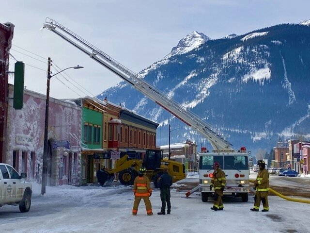 This photo provided by the San Juan County Colorado shows fire crews in Silverton, Colorado, mop up Sunday, Dec. 22, 2019, after a fire Saturday night destroyed a historic building and knocked out power, internet and cellphone service to the small, mountain town. Power was out for 6 hours as temperatures dipped below zero. The internet and cellphone services were restored early Monday, but residents are being asked to voluntarily conserve water for a couple of days until the town's storage tanks can be refilled. (DeAnne Gallegos/San Juan County Colorado via AP)