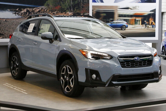 FILE- This Feb. 15, 2018, file photo shows a 2018 Subaru Crosstrek on display at the Pittsburgh Auto Show. Subaru is recalling over 400,000 vehicles in the U.S. to fix problems with engine computers and debris that can fall into motors. The first recall covers 466,000 Imprezas from 2017 through 2019, and 2018 and 2019 Crosstreks. (AP Photo/Gene J. Puskar, File)
