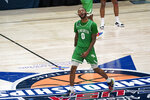 North Texas guard James Reese celebrates after the championship game against Western Kentucky in the NCAA Conference USA men's basketball tournament Saturday, March 13, 2021, in Frisco, Texas. North Texas won 61-57 in overtime. (AP Photo/Tony Gutierrez)