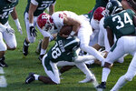 Michigan State cornerback Kalon Gervin (18) tackles Rutgers quarterback Johnny Langan after he crosses the goal line for a 1-yard touchdown during the first half of an NCAA college football game, Saturday, Oct. 24, 2020, in East Lansing, Mich. (AP Photo/Carlos Osorio)