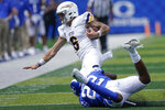Toledo quarterback Mitchell Guadagni (6) is tackled by Kentucky linebacker Chris Oats (22) during the second half of the NCAA college football game, Saturday, Aug. 31, 2019, in Lexington, Ky. (AP Photo/Bryan Woolston)