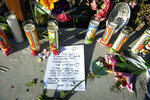 A handwritten message from members of the diving community is displayed at a memorial for the victims of Monday's dive boat fire at the Santa Barbara Harbor on Wednesday, Sept. 4, 2019, in Santa Barbara, Calif. (AP Photo/Christian Monterrosa )