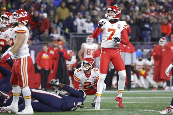 Kansas City Chiefs kicker Harrison Butker follows through on a successful field goal attempt in the first half of an NFL football game against the New England Patriots, Sunday, Dec. 8, 2019, in Foxborough, Mass. (AP Photo/Elise Amendola)