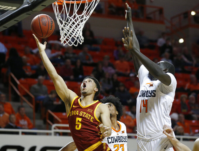 Iowa State guard Lindell Wigginton (5) shoots in front of Oklahoma State forward Yor Anei (14) during the second half of an NCAA college basketball game in Stillwater, Okla., Wednesday, Jan. 2, 2019. (AP Photo/Sue Ogrocki)