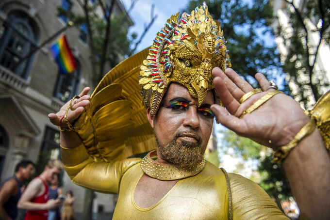 Ronaldo Pinto attends at Queer Liberation March in the West Village on Sunday, June 27, 2021, in New York. (AP Photo/Brittainy Newman)