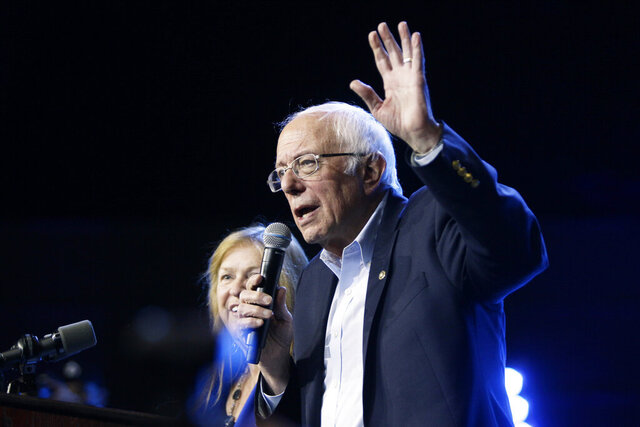 Democratic presidential candidate Sen. Bernie Sanders, I-Vt., with his wife Jane, speaks at his campaign event at Los Angeles Convention Center in Los Angeles, Sunday, March 1, 2020. (AP Photo/Damian Dovarganes)
