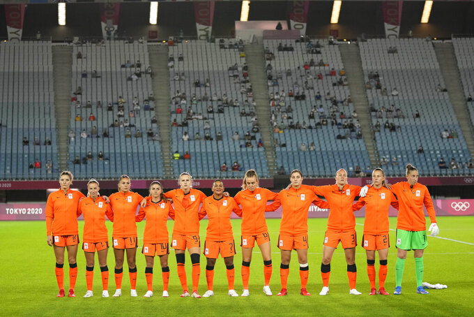 Netherlands gather during the national anthem prior to a women's soccer match against Brazil at the 2020 Summer Olympics, Saturday, July 24, 2021, in Miyagi, Japan. (AP Photo/Andre Penner)