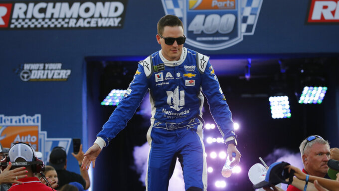 Alex Bowman greets fans during driver introductions for the NASCAR Monster Energy Cup series auto race at Richmond Raceway in Richmond, Va., Saturday, Sept. 21, 2019. (AP Photo/Steve Helber)