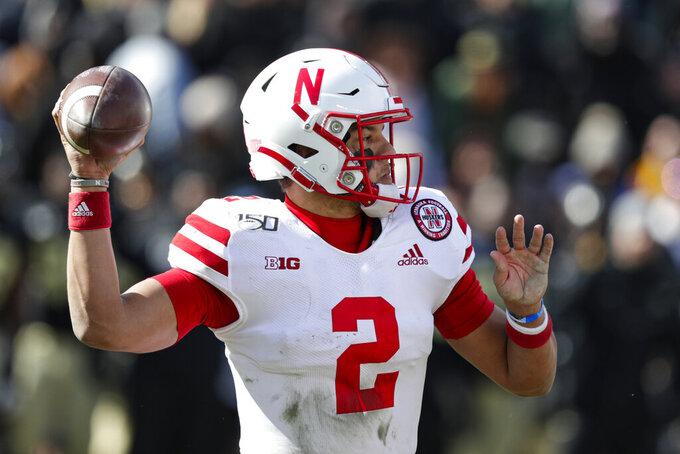 Nebraska quarterback Adrian Martinez (2) throws against Purdue during the second half of an NCAA college football game in West Lafayette, Ind., Saturday, Nov. 2, 2019. Purdue defeated Nebraska 31-27. (AP Photo/Michael Conroy)
