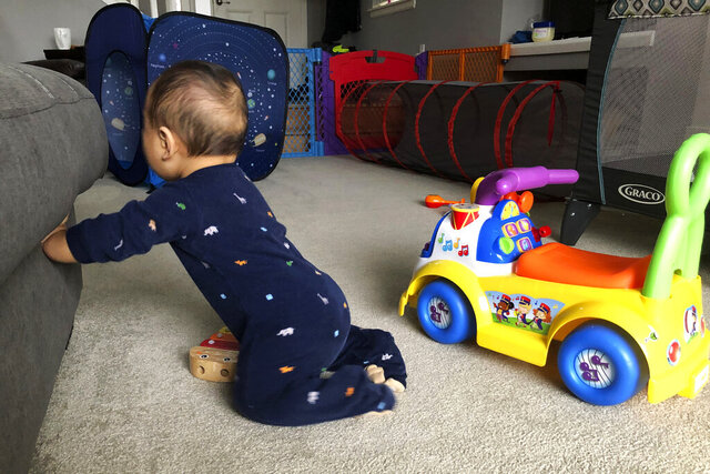 In this May 31, 2020, photo, the unending pandemic has intensified the finite period of babyhood for Associated Press writer Sally Ho, whose 8-month-old son, Clark, has spent 32 percent of his life under quarantine in Seattle. (AP Photo/Sally Ho)