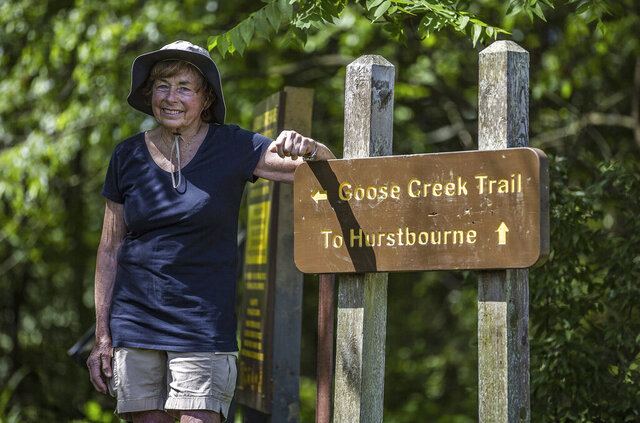 Patsy Harkess stops for a moment at the head of Goose Creek Trail in E.P. Tom Sawyer State Park during a recent hike on June 16, 2020, in Louisville, Ky. Harkess' plans to hike the Camino de Santiago in Spain were put on hold due to the COVID-19 pandemic, so she has been walking every day in local parks to raise money for ALS research.  (Jeff Faughender/Courier Journal via AP)