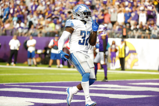 Detroit Lions running back D'Andre Swift (32) reacts as he scores on a 7-yard touchdown run during the second half of an NFL football game against the Minnesota Vikings, Sunday, Oct. 10, 2021, in Minneapolis. (AP Photo/Bruce Kluckhohn)