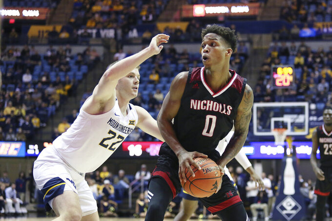 Nicholls State guard D'Angelo Hunter (0) is defended by West Virginia guard Sean McNeil (22) as he goes to pass the ball during the first half of an NCAA college basketball game Saturday, Dec. 14, 2019, in Morgantown, W.Va. (AP Photo/Kathleen Batten)