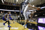 Vanderbilt forward Yanni Wetzell, right, saves the ball from going out of bounds in the second half of an NCAA college basketball game against UNC Asheville, Monday, Dec. 31, 2018, in Nashville, Tenn. (AP Photo/Mark Humphrey)
