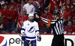 Referee Eric Furlatt (27) calls a two-minute boarding penalty on Tampa Bay Lightning defenseman Anton Stralman, from Sweden, for a hit on Washington Capitals right wing Tom Wilson during the first period of Game 3 of the NHL Eastern Conference finals hockey playoff series, Tuesday, May 15, 2018, in Washington. The Lightning won 4-2. (AP Photo/Alex Brandon)