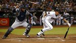 Arizona Diamondbacks' Zack Greinke, right, runs to first base on a sacrifice bunt as Milwaukee Brewers catcher Manny Pina, left, runs for the ball during the fifth inning of a baseball game Tuesday, May 15, 2018, in Phoenix. (AP Photo/Ross D. Franklin)