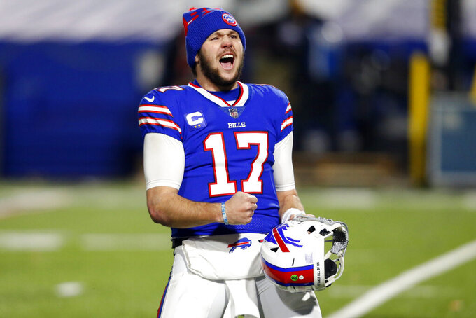 Buffalo Bills quarterback Josh Allen (17) celebrates after an NFL divisional round football game against the Baltimore Ravens Saturday, Jan. 16, 2021, in Orchard Park, N.Y. The Bills won 17-3. (AP Photo/Jeffrey T. Barnes)