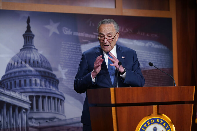 Senate Majority Leader Chuck Schumer, D-N.Y., speaks to reporters after final votes going into the Memorial Day recess, at the Capitol in Washington, Friday, May 28, 2021. Senate Republicans successfully blocked the creation of a bipartisan commission to study the Jan. 6 attack on the Capitol by rioters loyal to former President Donald Trump. (AP Photo/J. Scott Applewhite)