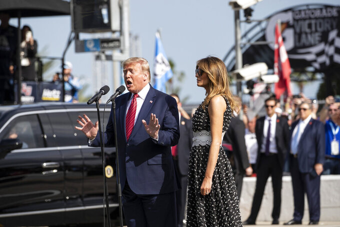 "President Donald Trump, accompanied by first lady Melania Trump, gives the instructions ""gentlemen, start your engines,"" before the start of the NASCAR Daytona 500 auto race at Daytona International Speedway, Sunday, Feb. 16, 2020, in Daytona Beach, Fla. (AP Photo/Alex Brandon)"