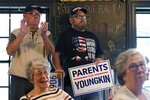 Supporters of Virginia Republican gubernatorial candidate Glenn Youngkin applaud their candidate during a rally in Culpeper, Va., Wednesday, Oct. 13, 2021. Youngkin faces former Gov. Terry McAuliffe in the November election. (AP Photo/Steve Helber)