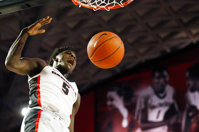 Georgia's Anthony Edwards celebrates a dunk against North Carolina Central during an NCAA college basketball game Wednesday, Dec. 4, 2019, in Athens, Ga. (Joshua L. Jones/Athens Banner-Herald via AP)