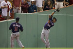 Minnesota Twins left fielder LaMonte Wade Jr., right, catches a fly ball by Boston Red Sox's Rafael Devers as shortstop Jorge Polanco (11) watches during the seventh inning of a baseball game at Fenway Park, Tuesday, Sept. 3, 2019, in Boston. (AP Photo/Elise Amendola)