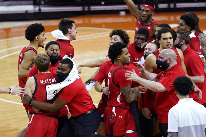 Texas Tech guard Mac McClung, front left, who hit the winning shot against Texas in the final seconds of an NCAA college basketball game, celebrates with teammates Wednesday, Jan. 13, 2021, in Austin, Texas. Texas Tech won 79-77. (AP Photo/Eric Gay)