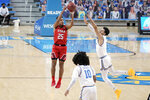 Utah guard Alfonso Plummer (25) shoots over UCLA guard Jules Bernard during the first half of an NCAA college basketball game Thursday, Dec. 31, 2020, in Los Angeles. (AP Photo/Marcio Jose Sanchez)