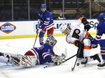 New York Rangers' Igor Shesterkin (31) stops a shot by Philadelphia Flyers' Wade Allison (57) in the first period of an NHL hockey game Thursday, April 22, 2021, in New York. (Elsa/Pool Photo via AP)