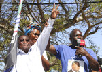 In this photo taken Tuesday, Sept. 10, 2019 opposition Renamo leader, Ossufo Momade, left, greets supporters at an election rally in Maputo, Mozambique. The country's elections on Tuesday, Oct 15, 2019 are almost certain to return the ruling party, Frelimo, and President Filipe Nyusi, to power but it is unclear if the results will establish badly needed stability and economic growth. (AP Photo/Ferhat Momade)