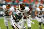 Miami defensive lineman Trevon Hill (94) sacks Central Michigan quarterback David Moore (2) during the first half of an NCAA college football game, Saturday, Sept. 21, 2019, in Miami Gardens, Fla. (AP Photo/Brynn Anderson)