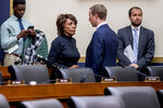 Chairwoman Rep. Maxine Waters, D-Calif., center left, speaks with Facebook CEO Mark Zuckerberg, center right, after he testifies before a House Financial Services Committee hearing on Capitol Hill in Washington, Wednesday, Oct. 23, 2019, on Facebook's impact on the financial services and housing sectors. (AP Photo/Andrew Harnik)