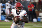FILE - Liberty quarterback Malik Willis (7) carries the ball against Troy during the first half of an NCAA football game in Troy, Ala., in this Saturday, Sept. 11, 2021, file photo. The Flames, behind former Auburn quarterback Malik Willis, have beaten Campbell (48-7) and Old Dominion (45-17) at home and edged Troy (21-13) on the road. They play at Syracuse on Friday night, Sept. 24. (AP Photo/Butch Dill, File)