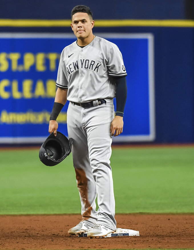 New York Yankees' Gio Urshela stands on second base after hitting a two-run double off Tampa Bay Rays starter Shane McClanahan during the fifth inning of a baseball game Tuesday, July 27, 2021, in St. Petersburg, Fla. (AP Photo/Steve Nesius)