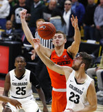 Colorado forward Lucas Siewert, front, battles for control of a rebound with Oregon State forward Tres Tinkle, center, as Colorado guard McKinley Wright IV looks on in the first half of an NCAA college basketball game Thursday, Jan. 31, 2019, in Boulder, Colo. (AP Photo/David Zalubowski)