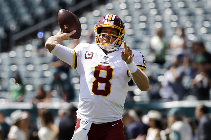 Washington Redskins' Case Keenum warms ups before an NFL football game against the Philadelphia Eagles, Sunday, Sept. 8, 2019, in Philadelphia. (AP Photo/Matt Rourke)
