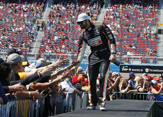 Corey LaJoie is greeted by fans during driver introductions prior to the start of the NASCAR Cup Series auto race at ISM Raceway, Sunday, March 10, 2019, in Avondale, Ariz. (AP Photo/Ralph Freso)