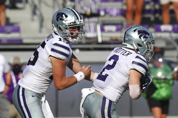 CORRECTS TO CITY TO FORT WORTH NOT ARLINGTON - Kansas State quarterback Will Howard (15) hands off to running back Harry Trotter (2) in the first quarter of an NCAA college football game against TCU, Saturday, Oct. 10, 2020, in Fort Worth, Texas. (AP Photo/Richard W. Rodriguez)