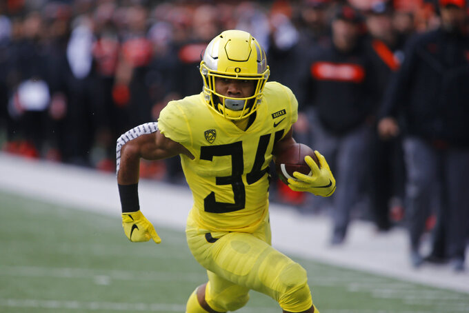 Oregon running back C.J. Verdell heads for a touchdown during the first half of an NCAA college football game against Oregon State in Corvallis, Ore., Friday, Nov. 23, 2018. (AP Photo/Timothy J. Gonzalez)