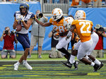West Virginia's David Sills (13) misses a catch in the end zone as Tennessee's Baylen Buchanan (28) defends in the first half of an NCAA college football game in Charlotte, N.C., Saturday, Sept. 1, 2018. (AP Photo/Chuck Burton)