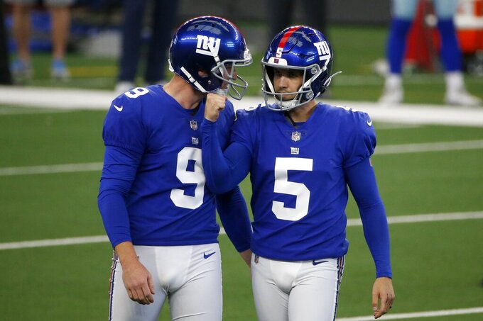 New York Giants punter Riley Dixon (9) and place kicker Graham Gano (5) celebrate a field goal kicked by Gano in the first half of an NFL football game against the Dallas Cowboys in Arlington, Texas, Sunday, Oct. 11, 2020. (AP Photo/Michael Ainsworth)