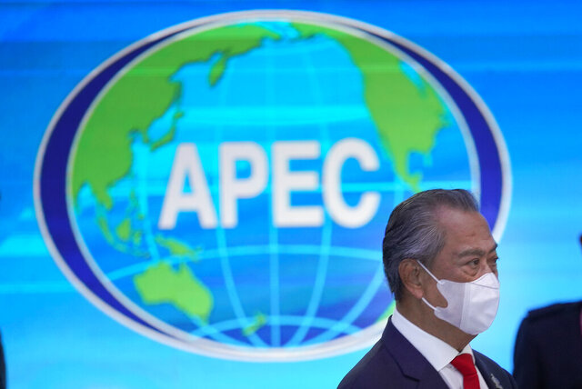 Malaysia's Prime Minister Muhyiddin Yassin, arrives for the opening of the first virtual Asia-Pacific Economic Cooperation (APEC) leaders' summit, hosted by Malaysia, in Kuala Lumpur, Malaysia, Friday, Nov. 20, 2020. (AP Photo/Vincent Thian)