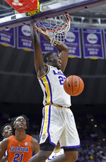 LSU forward Darius Days (22) dunks in front of Florida forward Dontay Bassett (21) during the first half of an NCAA college basketball game Wednesday, Feb. 20, 2019, in Baton Rouge, La. (AP Photo/Bill Feig)