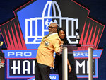 Donnie Shell poses with his daughter, April, after she presented him during the 2020 Centennial Pro Football Hall of Fame Class induction Saturday, Aug. 7, 2021, in Canton, Ohio. (Matt Freed/Pittsburgh Post-Gazette via AP)