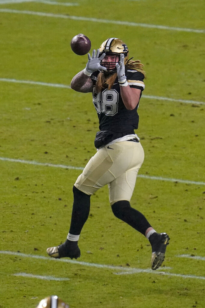 Purdue tight end Garrett Miller makes a catch against Northwestern on his way to a touchdown during the first half of an NCAA college football game in West Lafayette, Ind., Saturday, Nov. 14, 2020. (AP Photo/Michael Conroy)