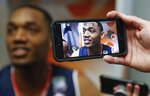 Auburn's Austin Wiley answers questions after a practice session for the semifinals of the Final Four NCAA college basketball tournament, Thursday, April 4, 2019, in Minneapolis. (AP Photo/Jeff Roberson)