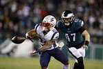 New England Patriots' James White (28) catches a pass against Philadelphia Eagles' Nate Gerry (47) during the second half of an NFL football game, Sunday, Nov. 17, 2019, in Philadelphia. (AP Photo/Matt Rourke)
